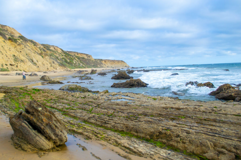 Photo of a rocky outcropping along Crystal Cove beach in southern California.